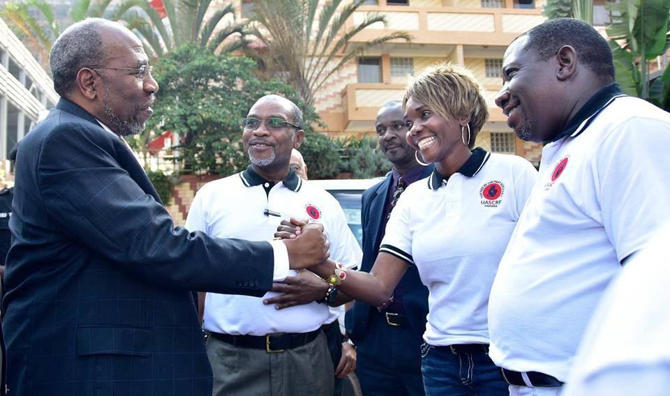 Rt Honorable Prime Minister of Uganda Dr Ruhakana Rugunda arrives at the 3rd Annual Sickle Cell conference at hotel Africana. In set  Dr Lukiah Mulumba, Mr Erostus Nsubuga, Dr Bulaimu Muwanga Kibirige and Dr Mutungi Gerald (Commisioner Non Communicable Diseases –Ministry of Health Uganda.
